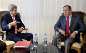 Kerry and Lavrov sit together during a photo opportunity prior to a meeting, in Geneva