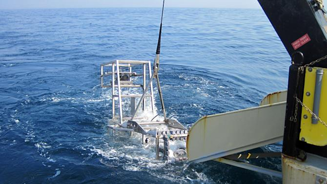 This June 2012 photo provided by the National Oceanic and Atmospheric Administration shows Seahorse, the latest and most sophisticated version of the marine habitat mapping camera system, HabCam, being recovered after a sea scallop survey off the Delaware coast. The apparatus was created to get better information about scallops, which bring fishermen a half-billion dollars in revenues annually. (AP Photo/NOAA)