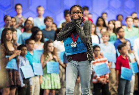 Jenna-May Ingal of Riverside, California, reacts to making the semi-finals of the 88th annual Scripps National Spelling Bee at National Harbor, Maryland