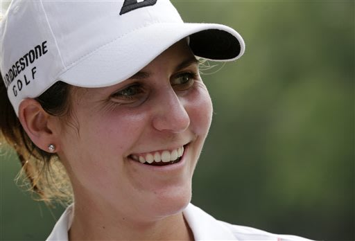 Jennifer Johnson is all smiles after winning the Mobile Bay LPGA Classic golf tournament at the Robert Trent Jones Golf Trail at Magnolia Grove in Mobile, Ala. Sunday, May 19, 2013