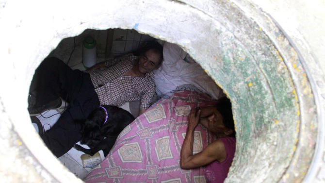 Restrepo and wife Garcia are seen from their sewer home in Medellin
