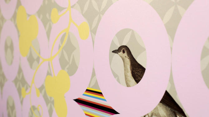This photo taken Sunday, March 3, 2013, provided by Sarah Rowland shows a detail of custom wallpaper that Sarah Rowland designed for Dixie Donuts in Richmond, Va. Owners Betsy Thomas and J Frank asked Rowland to design a custom wallpaper for an accent wall at the shop located in the trendy Carytown section of Richmond. (AP Photo/Sarah Rowland, Jay Paul)