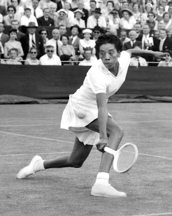 FILE - In this June 26, 1956 file photo, trailblazing tennis star Althea Gibson competes in the first round of Wimbledon, in England. Gibson, who went on to win the French Open, the U.S. Nationals and