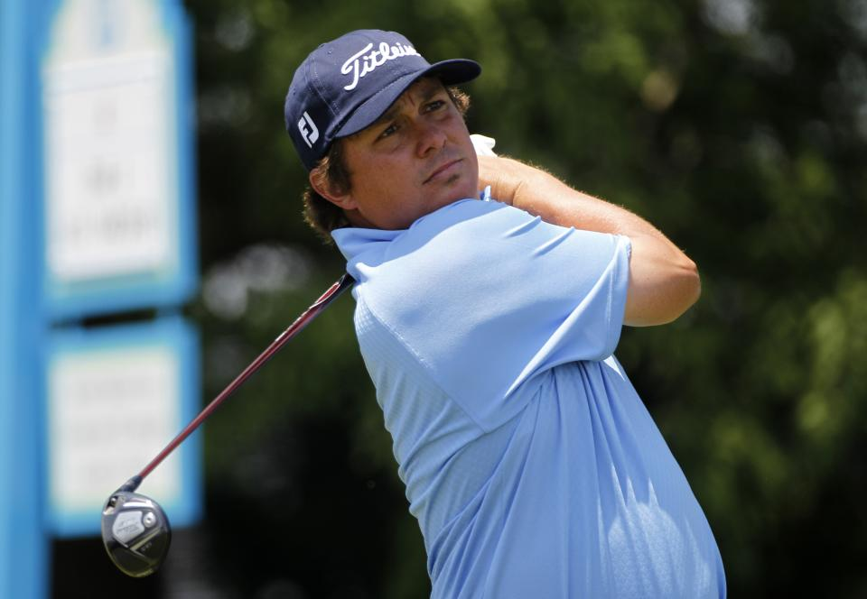 Jason Dufner watches his shot off the fourth tee during the final round of the PGA Byron Nelson Championship golf tournament on Sunday, May 20, 2012, in Irving, Texas. (AP Photo/Tony Gutierrez)