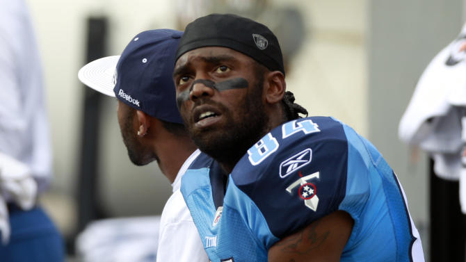 Tennessee Titans' Randy Moss sits on the bench during the NFL football game against the Miami Dolphins in Miami, Sunday, Nov. 14, 2010. The Dolphins won 29-17. Moss had just one catch during the game. (AP Photo/Alan Diaz)