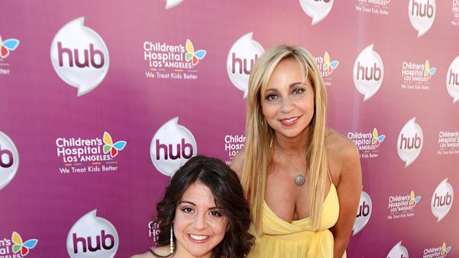 "IMAGE DISTRIBUTED FOR THE HUB - Jennifer Bricker, left, and Tara Strong attend The Hub TV Network's ""My Little Pony Friendship is Magic"" Coronation Concert at the Brentwood Theatre on Saturday, Feb. 9, 2013, in Los Angeles in support of Children's Hospital LA. (Photo by Matt Sayles/Invision for The Hub/AP Images)"