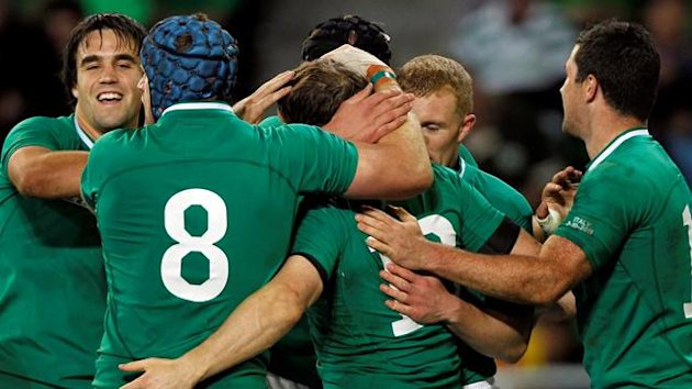 Ireland captain Brian O'Driscoll (C) celebrates with teammates after scoring a try during their Rugby World Cup Pool C match against Italy at Otago Stadium in Dunedin
