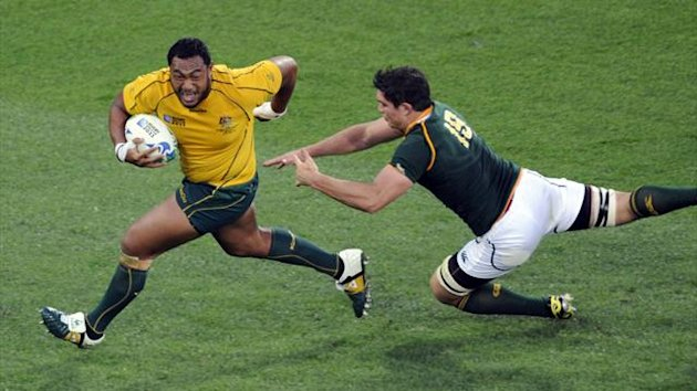 Australia Wallabies' Sekope Kepu (L) avoids South Africa Springboks' Francois Louw as he runs with the ball behind the try line during their Rugby World Cup quarter-final match at Wellington Regional Stadium October 9, 2011