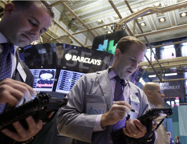 Traders work on the floor of the New York Stock Exchange Friday, Sept. 7, 2012. Stocks are opening mixed on Wall Street following news that the U.S. economy added fewer jobs than expected in August. (