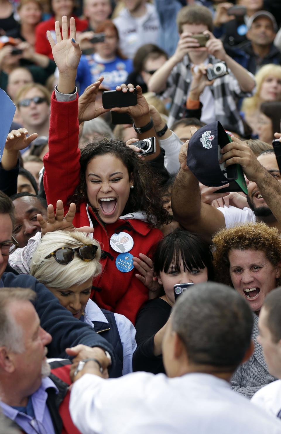 A supporter reacts after greeting President Barack Obama at a campaign event at Elm Street Middle School, Saturday, Oct. 27, 2012 in Nashua, N.H. (AP Photo/Pablo Martinez Monsivais)