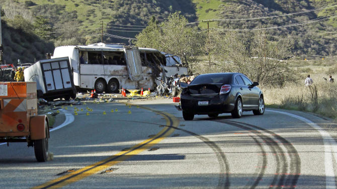 Skid marks from a tour bus are seen Monday, Feb. 4, 2013, after the bus, background, collided with two other vehicles and crashed Sunday, killing at least eight people and injuring 38, on Highway 38 just north of Yucaipa, Calif.  The bus was carrying a tour group from Tijuana, Mexico.  (AP Photo/Reed Saxon)