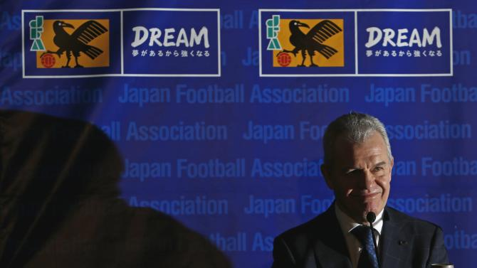 Japan's national soccer team head coach Aguirre of Mexico smiles during a news conference at the Japan Football Association headquarters in Tokyo