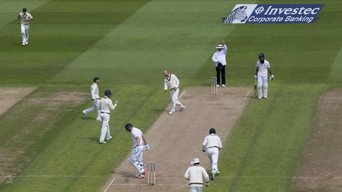 Australia's Nathan Lyon, centre, celebrates taking the wicket of England's Jos Buttler, bottom left, LBW for 9 on the second day of the third Test match of the five match series between England and Australia at Edgbaston cricket ground in Birmingham, England, Thursday, July 30, 2015. (AP Photo/Jon Super)