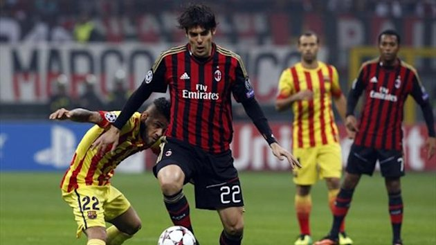 AC Milan's Kaka (R) challenges Daniel Alves (L) of Barcelona during their Champions League match at the San Siro (Reuters)