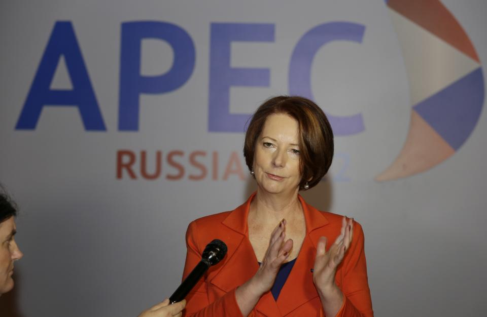 Australian Prime Minister Julia Gillard gestures as she talks to reporters soon after her arrival at the APEC summit in Vladivostok, Russia, Friday, Sept. 7, 2012. (AP Photo/Mark Baker)