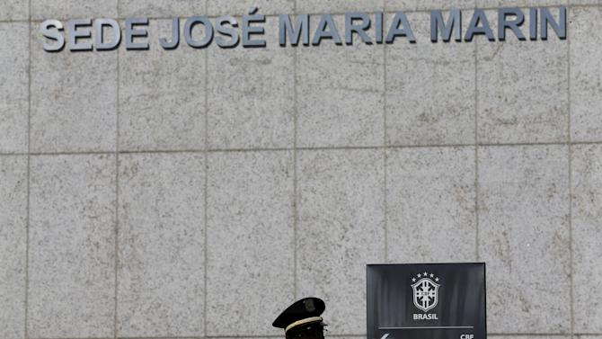 A security guard stands outside the Brazilian Football Association (CBF) headquarters in Rio de Janeiro