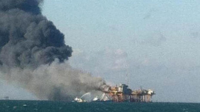 In this image released by a oil field worker and obtained by the Associated Press, a fire burns on a Gulf oil platform Friday, Nov. 16, 2012, after an explosion on the rig, in the Gulf of Mexico off the Louisiana coast. An explosion and fire ripped through a Gulf oil platform Friday as workers used a cutting torch, sending at least four people to a hospital with burns and leaving two missing in waters off Louisiana. (AP Photo)