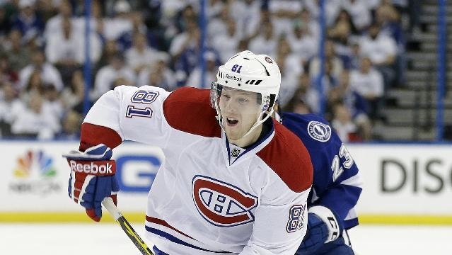 Montreal Canadiens center Lars Eller (81), of Denmark, shoots against the Tampa Bay Lightning during the first period of Game 2 of a first-round NHL hockey playoff series Friday, April 18, 2014, in Tampa, Fla