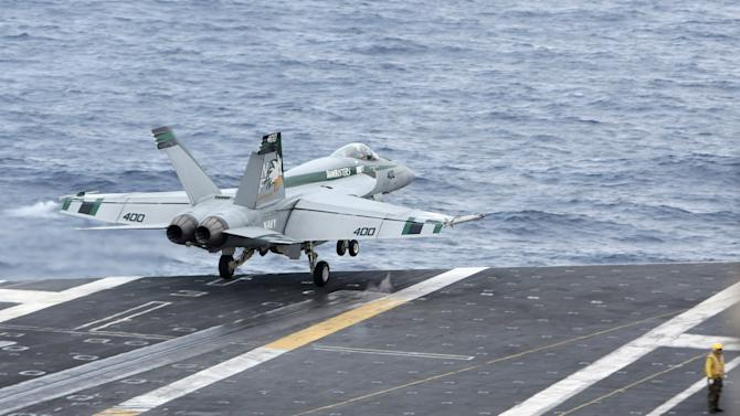 An F/A-18 Super Hornet takes off from the USS George Washington