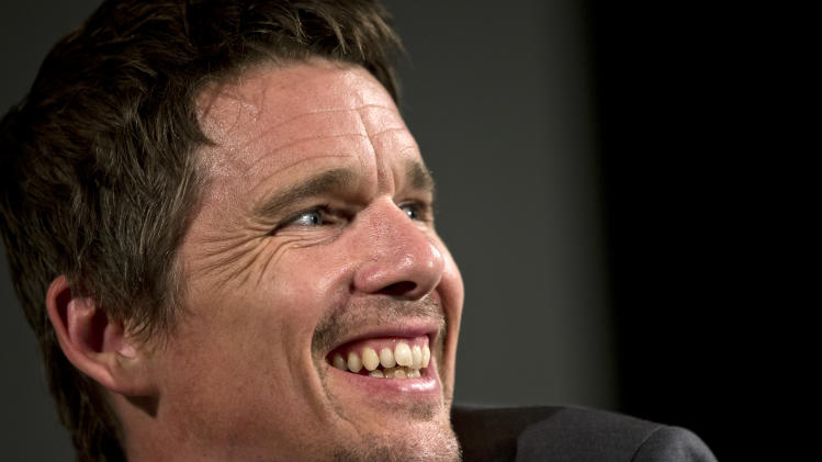 "US actor Ethan Hawke smiles during a press conference in Bucharest, Romania, Wednesday, June 26, 2013. Hawke made a plea for all children to be educated from a young age, arriving in Romania where he promoted his recent film ""Before Midnight."" Hawke also spoke about his mother Leslie Hawke's work with some of Romania's most impoverished young children whom she has been raising awareness and funds for to get them a kindergarten education since she arrived in Romania as a Peace Corp volunteer in 2000.(AP Photo/Vadim Ghirda)"