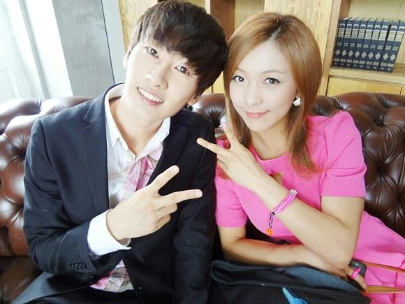 Luna & Eun Hyuk in pink outfits, looking like actual lovers