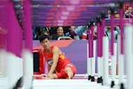 China's Liu Xiang falls at the first hurdle during the men's 110m heat at the London Olympics on August 7. Liu got up and hopped down the track to symbolically cross the finish line, winning warm applause from a stunned 80,000 crowd