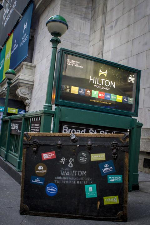 A Hilton ad is placed in front of the the New York Stock Exchange to celebrate of the company's IPO