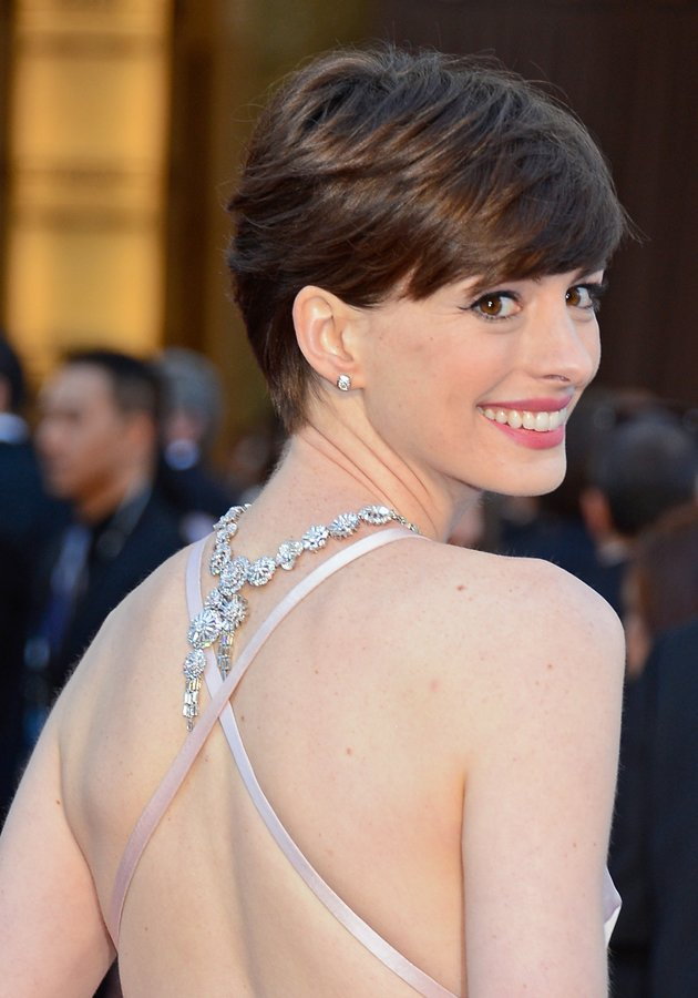 Anne Hathaway showcased a decorative diamond necklace and a cross back