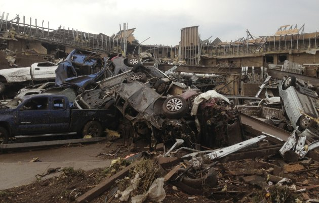 Overturned cars are seen after huge tornado strikes near Oklahoma City