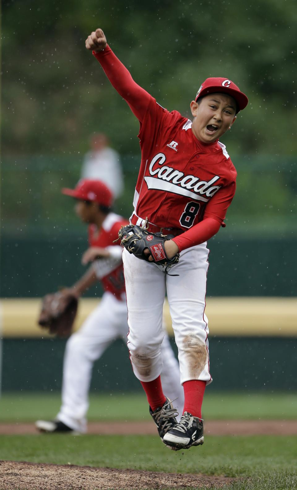 Vancouver, British Columbia's Ataru Yamaguchi reacts after getting Nuevo Laredo, Mexico's Marcelo Perez to fly out to end a pool play baseball game at the Little League World Series, Friday, Aug. 17, 2012, in South Williamsport, Pa. Canada won 13-9. (AP Photo/Matt Slocum)