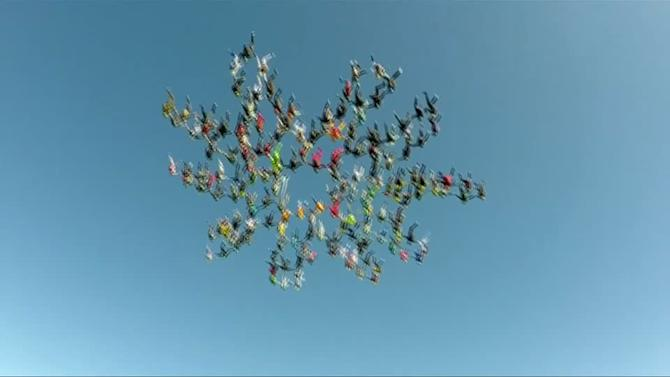 Skydivers break world record with flower formation