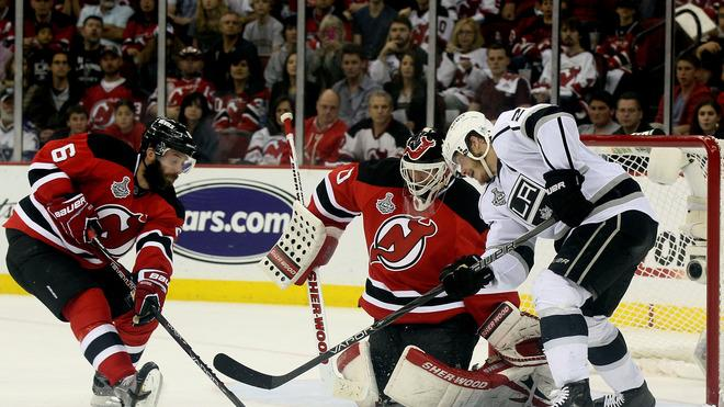 Andy Greene #6 Of The New Jersey Devils Goes For A Loose Puck Against Dustin Brown #23 Of The Los Angeles Kings In  Getty Images