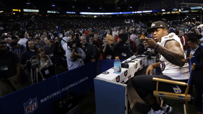 Baltimore Ravens linebacker Terrell Suggs answers a question during media day for the NFL Super Bowl XLVII football game Tuesday, Jan. 29, 2013, in New Orleans. (AP Photo/Pat Semansky)