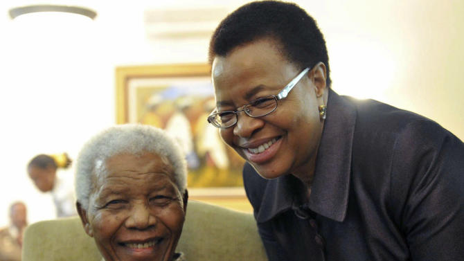 "FILE  -  May 16, 2011 file photo supplied by the South African Government Communications and Information Services, GCIS, showing former South African President Nelson Mandela and his wife Graca Machel  at his home in Johannesburg, South Africa. Mandela was admitted to a hospital on Saturday March 9 2013 for a scheduled medical check-up and doctors say there is no cause for ""alarm,"" the president's office said. Presidential spokesman Mac Maharaj said 94-year-old Mandela went in the afternoon for tests ""to manage existing conditions in line with his age"" at a hospital in Pretoria.  (AP Photo/Elmond Jiyane-GCIS, File)"
