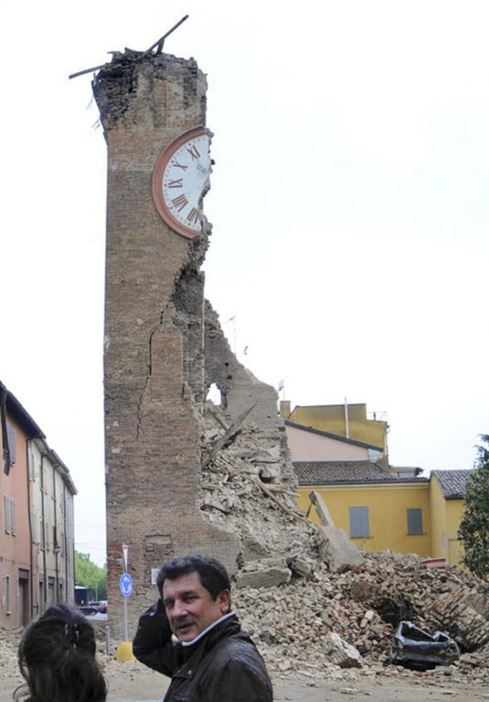 The damaged medieval clock tower of Finale Emilia, Italy, Sunday, May 20, 2012, following the magnitude 6.0 earthquake that shook northern Italy early Sunday and literally cut the tower in two.  A second quake on Sunday afternoon tore it down completely. (AP Photo/Gianfilippo Oggioni, Lapresse)