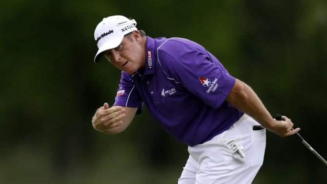 D.A. Points gestures for his ball to curve on the 16th green during the final round of the PGA Zurich Classic golf tournament at TPC Louisiana in Avondale, La., Sunday, April 28, 2013. (AP Photo/Gerald Herbert)