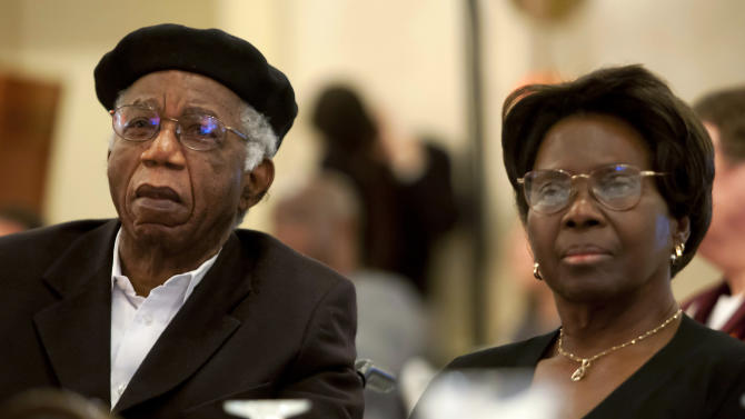 """This 2010 photo provided by Brown University shows Chinua Achebe, left, with his wife Christie Achebe on campus in Providence, R.I. Achebe, an internationally celebrated Nigerian author, statesman and dissident, has died at age 82. Achebe's 1958 novel, """"Things Fall Apart,"""" is widely regarded as the first major work of modern African fiction and inspired others to tell the continent's story through the eyes of those who lived there. (AP Photo/Brown University, Mike Cohea)"""