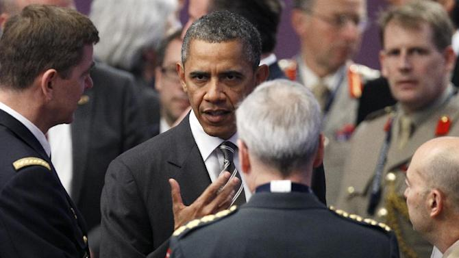 President Barack Obama mingles before the meeting on Afghanistan during the NATO Summit, Monday, May 21, 2012, in Chicago. (AP Photo/Carolyn Kaster)