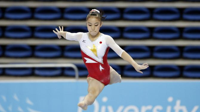 Japan's Sakura Yumoto competes on the beam event of the women's team final gymnastics competition at the Namdong Gymnasium Club during the 17th Asian Games in Incheon