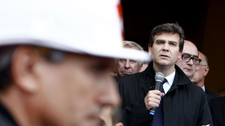 FOR STORY SLUGGED FRANCE SHRINKING ECONOMY - FILE -  In this Sept. 27, 2012 file photo, French Minister for Industrial Recovery Arnaud Montebourg delivers a speech after meeting workers and trade union representatives of ArcelorMittal, in Florange, northeast France.  The 50-year old lawyer Montebourg, is the man charged with reviving France's shrinking economy and attracting businesses to invest in the country, but according to some analysts he is fast gaining a reputation for doing the opposite, as public spats with international companies, and efforts to block employee layoffs are being seen as the epitome of what is wrong with the French economy. (AP Photo/Mathieu Cugnot, File)