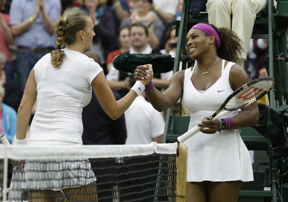 Serena Williams of the United States, right, is congratulated by Petra Kvitova of the Czech Republic after a quarterfinals match at the All England Lawn Tennis Championships at Wimbledon, England, Tuesday, July 3, 2012. (AP Photo/Anja Niedringhaus)