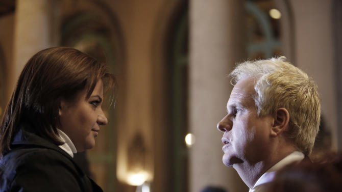 Attorney Vance Owen, right, speaks with Cynthia Rivera, sister of victim Arturo Rivera, as they announce a lawsuit on behalf of four associates of Mexican singer Jenni Rivera, who perished along with her in a plane crash in Mexico in December, at a news conference in Los Angeles Thursday, Jan. 10, 2013. Cynthia Rivera and Arturo Rivera are not related to Jenni Rivera. (AP Photo/Reed Saxon)