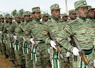 Tamil Tiger guerrillas take part in a 2003 military parade in the northern town of Pallai. The last leader of Sri Lanka&#39;s Tamil Tigers has been freed from military custody, the defence ministry says. Selvarasa Pathmanathan is wanted by India over the assassination of former premier Rajiv Gandhi