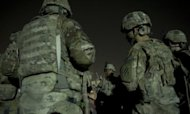 Infantry men from the 1st platoon, Delta coy. attend a briefing prior to embarking on a night patrol from Lindsey foward operating base, on September 15, in Kandahar province. A suspected policeman on Sunday killed four NATO troops in Afghanistan, the US-led military said, the second apparent attack in which Afghan security forces have killed their Western allies in two days