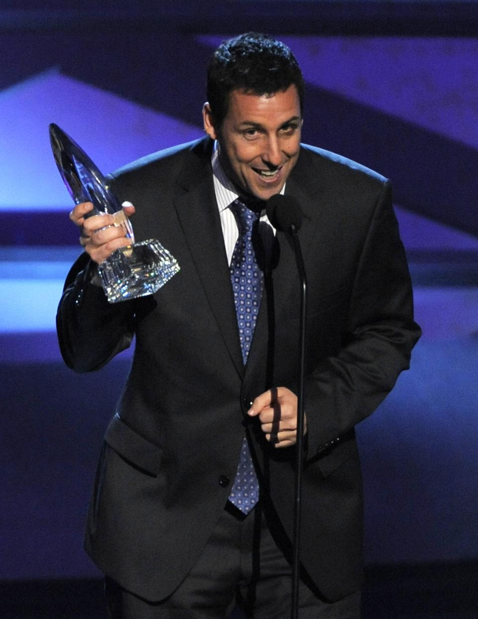 Adam Sandler accepts the award for favorite comedic star at the People's Choice Awards on Wednesday, Jan. 5, 2011, in Los Angeles. (AP Photo/Chris Pizzello)