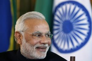 India's PM Modi reacts during a meeting with Brazil's President Rousseff on the sidelines of the 6th BRICS summit at the Alvorada Palace in Brasilia