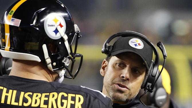 In this photo taken Oct. 20, 2014, Pittsburgh Steelers offensive coordinator Todd Haley, right, talks with quarterback Ben Roethlisberger on the sideline during an NFL football game against the Houston Oilers in Pittsburgh. Haley's constant tinkering with formations and personnel is by design, even if his players admit sometimes they never know what is coming next