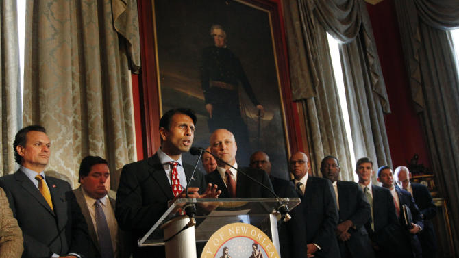 Louisiana Gov. Bobby Jindal, foreground, and New Orleans Mayor  Mitch Landrieu, right of Jindal, speak at a news conference with local government and business leaders regarding efforts to keep the New Orleans Hornets NBA basketball franchise in the city, in New Orleans, Monday, Dec. 13, 2010. (AP Photo/Gerald Herbert)