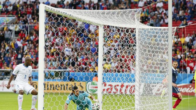 Honduras' goalkeeper Noel Valladares bundles a shot from France's Karim Benzema, far right, into his net for an own goal during the group E World Cup soccer match between France and Honduras at the Estadio Beira-Rio in Porto Alegre, Brazil, Sunday, June 15, 2014. (AP Photo/Jon Super)