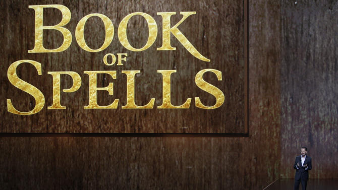 """Andrew House, President of Sony Computer Entertainment Europe, introduces """"Book of Spells"""" at the Sony Electronic Entertainment Expo (E3) news conference in Los Angeles, Monday, June 4, 2012. (AP Photo/Jason Redmond)"""